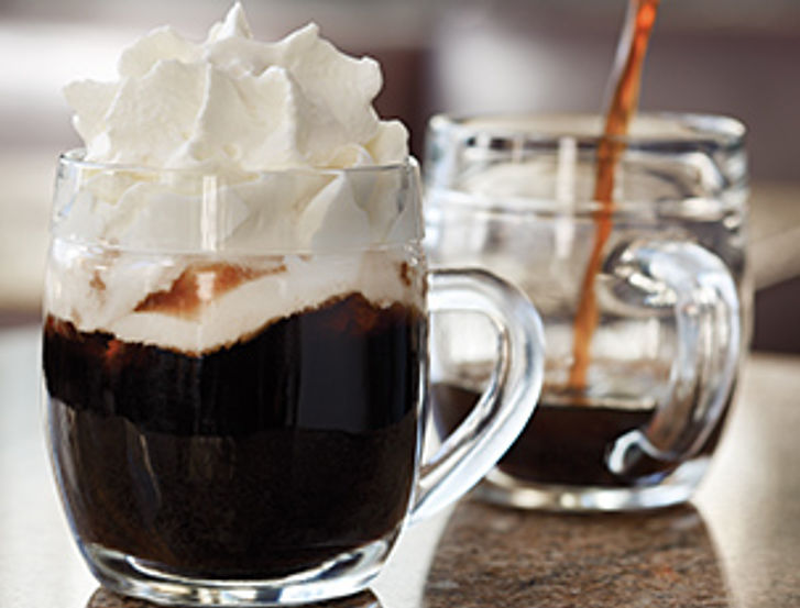 Coffee speciality with mocca and whipped cream, served in a special type of glass.